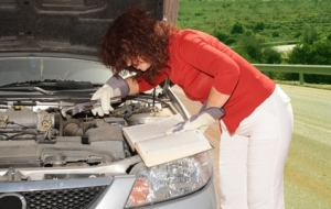 """Who needs an auto repair shop?  The manual makes it easy.  By linking the windshield wiper mechanism to the radiator cooling system and bypassing the fuel injection pistons I should correct the """"empty gas tank"""" problem."""